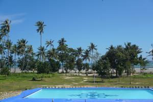 The swimming pool at or near Eastwind Beach Club