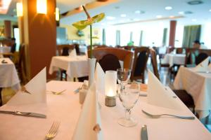 A restaurant or other place to eat at Airport Hotel Budapest