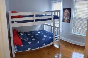 A bunk bed or bunk beds in a room at President's Residence