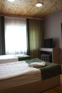 A bed or beds in a room at Touristic Complex Park Sagaan Morin