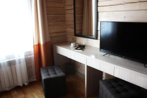 A television and/or entertainment centre at Touristic Complex Park Sagaan Morin