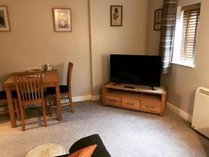 A television and/or entertainment centre at Clarabel's Guest House- The Nook