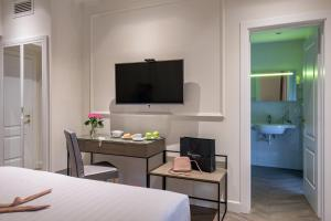 A television and/or entertainment center at Best Western Hotel Astrid