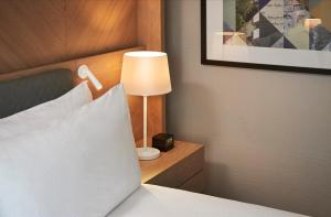 A bed or beds in a room at Hilton London Croydon