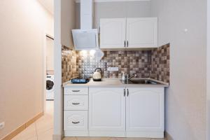 Kuchyň nebo kuchyňský kout v ubytování All Seasons