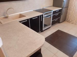 A kitchen or kitchenette at Квартира ЖК Солнечный