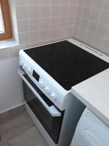 A cozinha ou cozinha compacta de Casa Geppetto