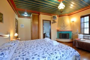 Ένα ή περισσότερα κρεβάτια σε δωμάτιο στο Ο Ξενώνας του Νικόλα