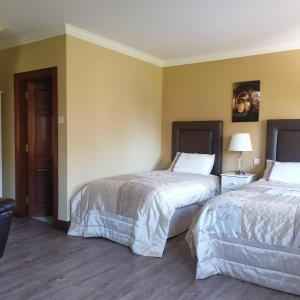 A bed or beds in a room at Cloghan Lodge