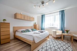 Łóżko lub łóżka w pokoju w obiekcie Corka Rybaka Apartments