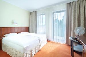 Łóżko lub łóżka w pokoju w obiekcie Pokoje Fregata