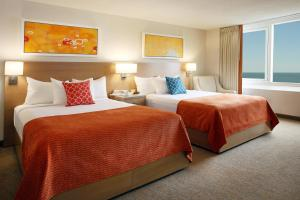 A bed or beds in a room at Tropicana Casino and Resort