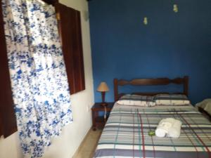 A bed or beds in a room at Pousada Brisa Marinha