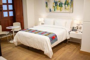 Cama ou camas em um quarto em Domingo Santo Hotel Boutique