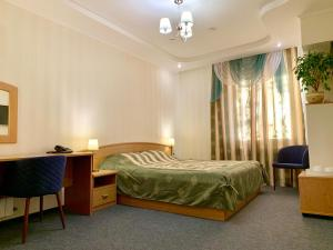 A bed or beds in a room at Business Hotel Kostroma