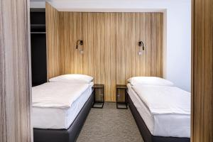 A bed or beds in a room at Harmony Club Hotel