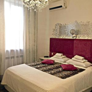 A bed or beds in a room at Boutique hotel 9