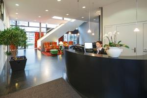 The lobby or reception area at Baslertor Swiss Quality Hotel