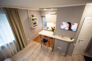 A television and/or entertainment center at Lesi 3 Studio Apartment