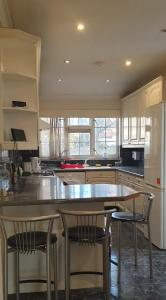 A kitchen or kitchenette at Spacious double ensuite room