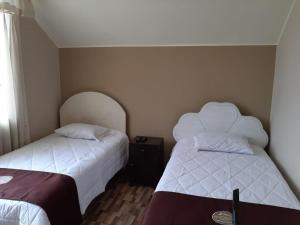 A bed or beds in a room at SANTERRA