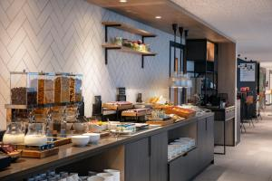 A restaurant or other place to eat at Hilton Garden Inn Paris Orly Airport
