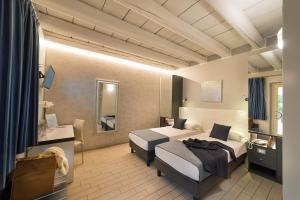 Letto o letti in una camera di Albergo Fontana Verona