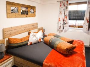 Ein Bett oder Betten in einem Zimmer der Unterkunft Ferienwohnung Lederle