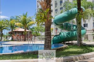 The swimming pool at or close to TOP 2 Quartos com VARANDA em Condominio com PISCINA, Portaria 24h e Estacionamento - Estrutura de Lazer para CRIANCAS - Apto com Ar Condicionado e Wi-Fi 100mbps