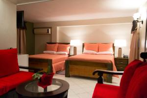 A bed or beds in a room at Constellation Hotel