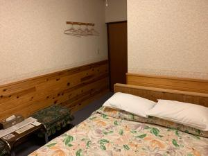 A bed or beds in a room at Turtle Inn Nikko