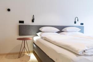 Ein Bett oder Betten in einem Zimmer der Unterkunft Mari Pop Boutique Hotel