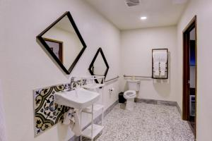 A bathroom at The Greens Hotel on Stockton
