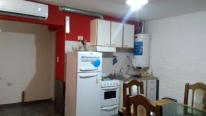 A kitchen or kitchenette at total servicios