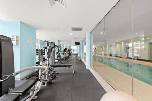 The fitness center and/or fitness facilities at Opera House Views North Sydney Apt, Mins to CBD