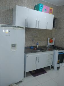 A kitchen or kitchenette at Residêncial primavera