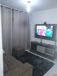 A television and/or entertainment centre at Residêncial primavera