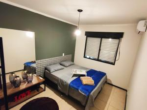 A bed or beds in a room at Apto prox HSVP c/ garagem