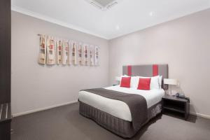 A bed or beds in a room at Platinum International