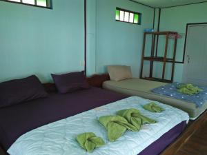 A bed or beds in a room at Happy Days Resort