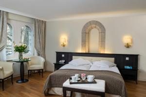 Ein Bett oder Betten in einem Zimmer der Unterkunft Château d'Ouchy