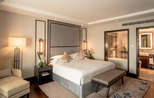 A bed or beds in a room at Taj Coromandel
