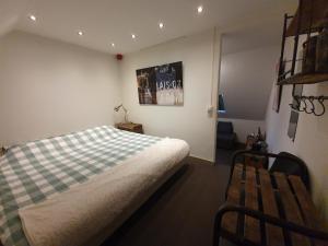 Een bed of bedden in een kamer bij Slapen Bij Brownies & Downies