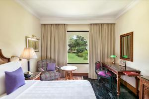 A bed or beds in a room at Trident Udaipur