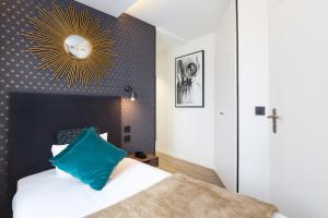 A bed or beds in a room at Hotel OHM by Happyculture