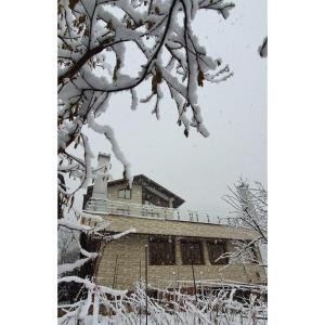 Guest House Khristofor during the winter