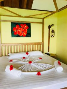 A bed or beds in a room at Patatran Village Hotel