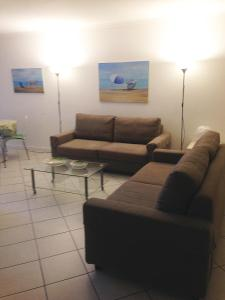 A seating area at Nizza Francia Apartment