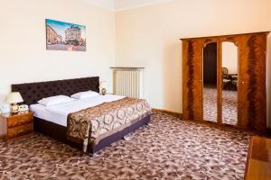 Кровать или кровати в номере Жорж Отель