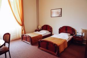 Ліжко або ліжка в номері Готель Жорж